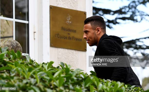 France's midfielder Corentin Tolisso arrives at the French national football team training base in Clairefontaine near Paris on March 20 as part of...