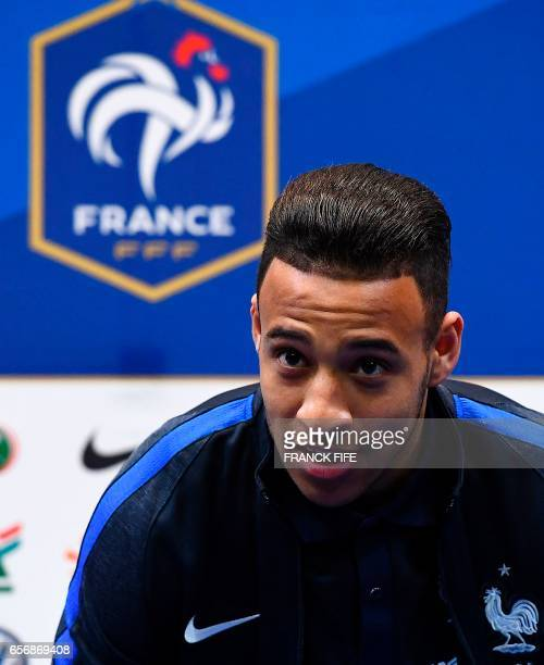 France's midfielder Corentin Tolisso arrives to give a press conference on March 23 in Clairefontaine near Paris as part of the team's preparation...