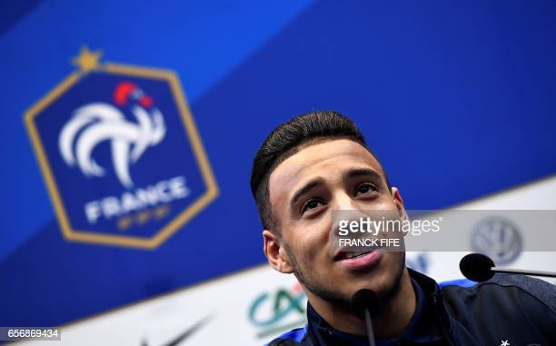 France's midfielder Corentin Tolisso gives a press conference on March 23 in Clairefontaine near Paris as part of the team's preparation for the...