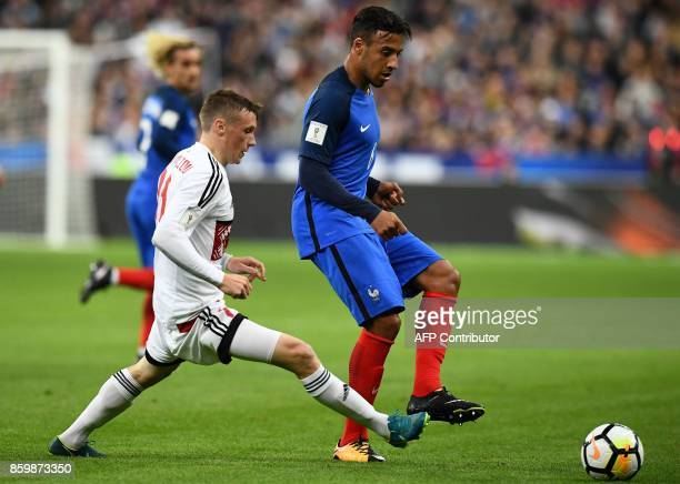 France's midfielder Corentin Tolisso kicks the ball during the FIFA World Cup 2018 qualification football match between France and Belarus at the...