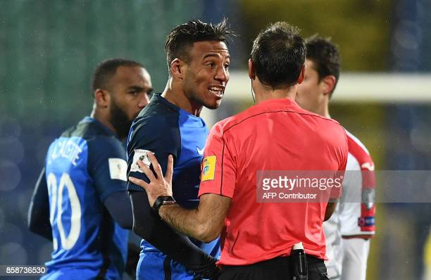 France's midfielder Corentin Tolisso reacts as he speaks with referee Antonio Mateu Lahoz during the FIFA World Cup 2018 qualifying football match...
