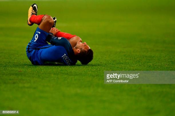 France's midfielder Corentin Tolisso reacts during the FIFA World Cup 2018 qualification football match between France and Belarus at the Stade de...