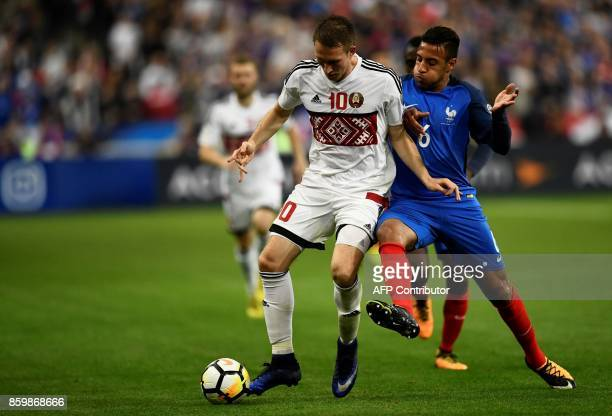 France's midfielder Corentin Tolisso vies for the ball with Belarus' forward Anton Saroka during the FIFA World Cup 2018 qualification football match...