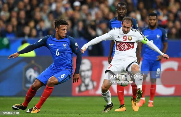 France's midfielder Corentin Tolisso vies for the ball with Belarus' midfielder Igor Stasevich during the FIFA World Cup 2018 qualification football...