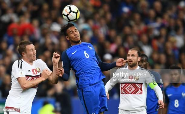 France's midfielder Corentin Tolisso vies for the ball with Belarus' midfielder Igor Stasevich R and Belarus' forward Anton Saroka during the FIFA...