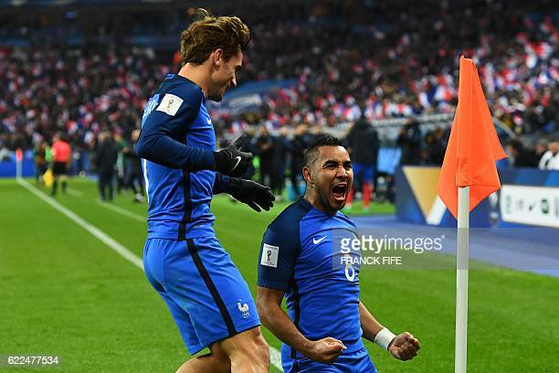 France's midfielder Dimitri Payet celebrates with France's forward Antoine Griezmann after scoring a goal during the 2018 World Cup group A...