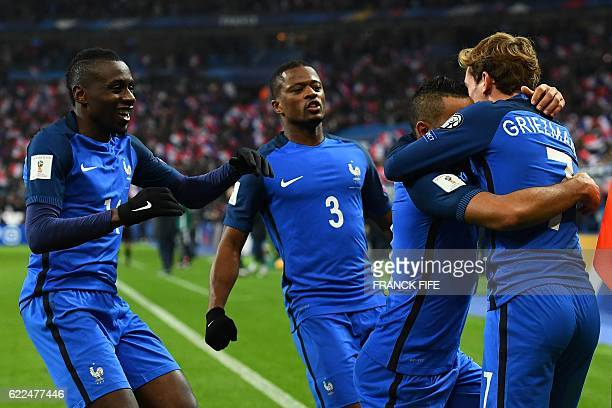 France's midfielder Dimitri Payet celebrates with teammates after scoring a goal during the 2018 World Cup group A qualifying football match between...