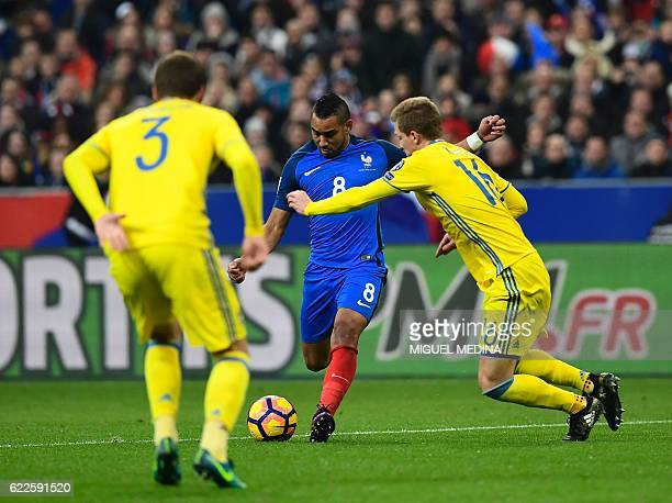 France's midfielder Dimitri Payet vies with Sweden's Victor Nilsson Lindelöf and Sweden's defender Emil Krafth during the 2018 World Cup group A...