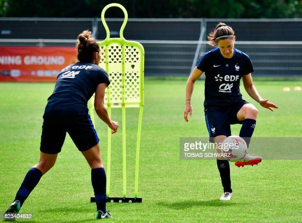 France's midfielder Elise Bussaglia takes part in a training session during the UEFA Women's Euro 2017 football tournament in Zwijndrecht on July 27...