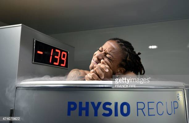 France's midfielder Elodie Thomis reacts as she undergoes treatment in a medical device used for cryotherapy at the French national football team...