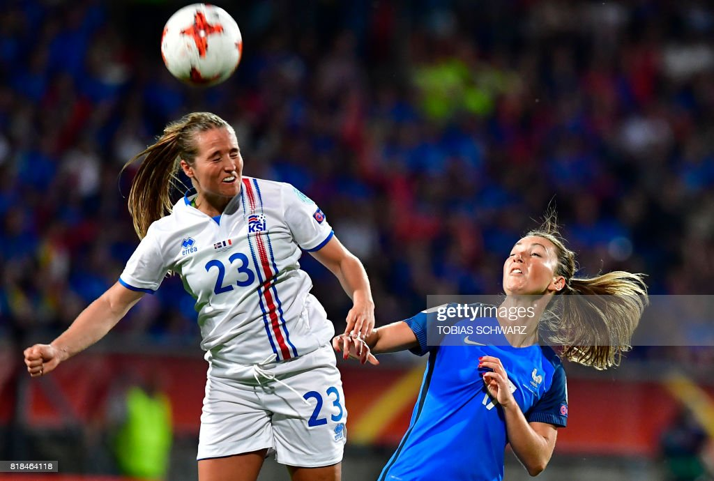 France's midfielder Gaetane Thiney (R) and Iceland's forward Fanndis Fridriksdottir go for a header during the UEFA Women's Euro 2017 football tournament match between France and Iceland at Stadium Koning Wilhelm II in Tilburg on July 18, 2017. /