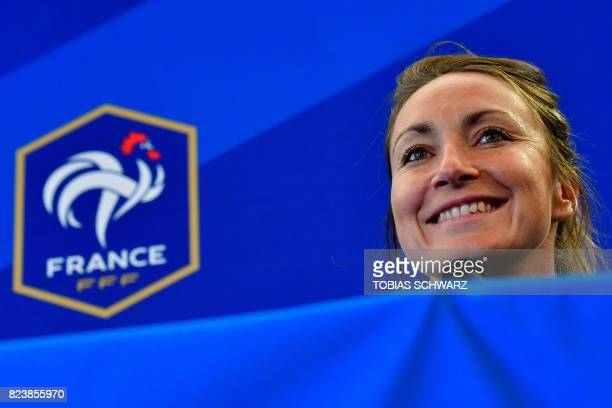 France's midfielder Gaetane Thiney smiles during a press conference during the UEFA Women's Euro 2017 football tournament in Zwijndrecht on July 28...