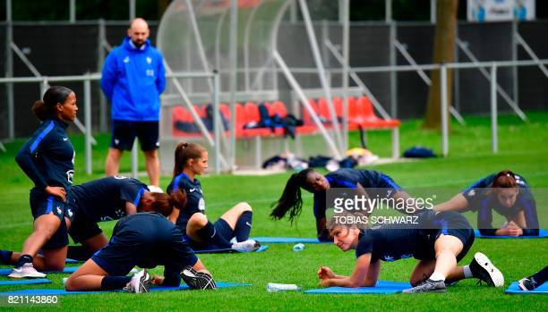 France's midfielder Gaetane Thiney stretches during a training during the UEFA Women's Euro 2017 football tournament in Zwijndrecht on July 23 2017 /...