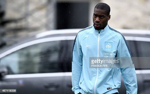 France's midfielder Geoffrey Kondogbia arrives for a press conference two days ahead of a friendly match against Brazil on March 24 2015...