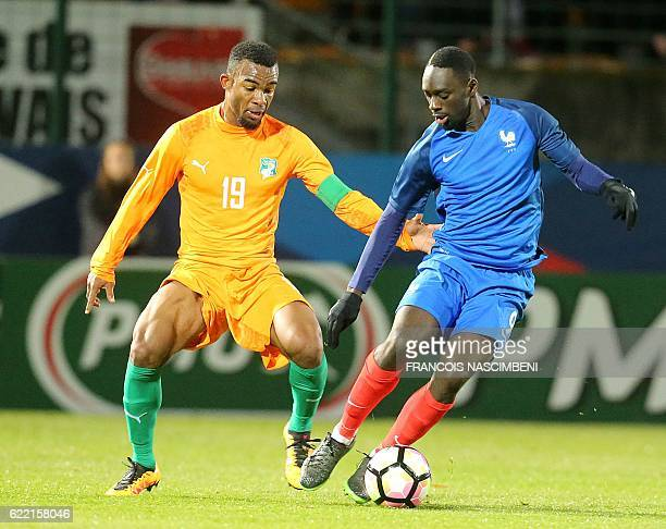 France's midfielder JeanKevin Augustin vies with Ivory Coast's captain Digbo Habib Maiga during the friendly international U21 football match between...