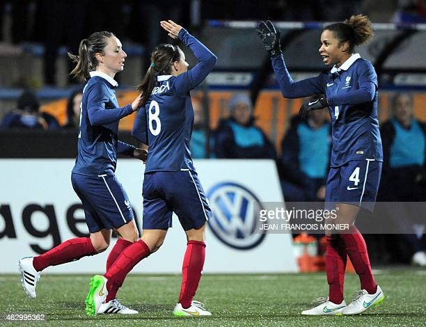 France's midfielder Kenza Dali and France's defender Laura Georges congratuled France's defender Jessica Houara after she scored during the Women's...