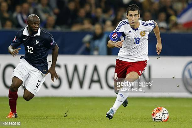 France's midfielder Lassana Diarra vies for the ball with Armenia's captain and midfielder Henrikh Mkhitaryan during the friendly football match...