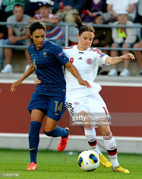 France's midfielder Louisa Necib and Denmark's defender Mia Brogaard vie for the ball during the UEFA Women's European Championship Euro 2013 quarter...