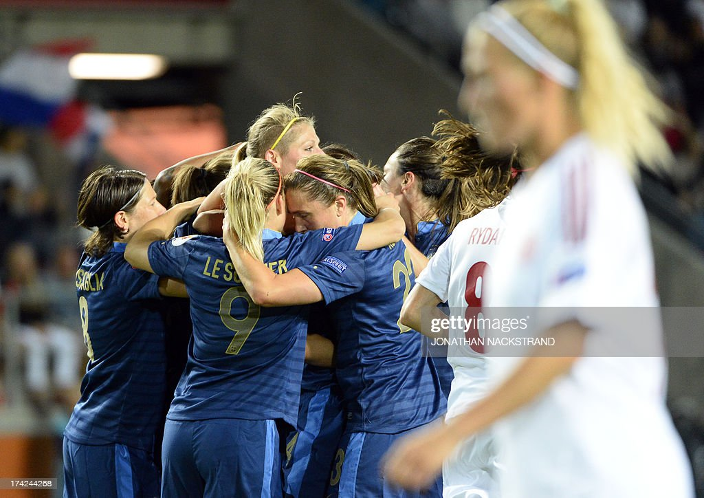 France's midfielder Louisa Necib (2nd-R) celebrates with teammates after scoring a penalty during the UEFA Women's European Championship Euro 2013 quarter final football match France vs Denmark on July 22, 2013 in Linkoping, Sweden. AFP PHOTO/JONATHAN NACKSTRAND