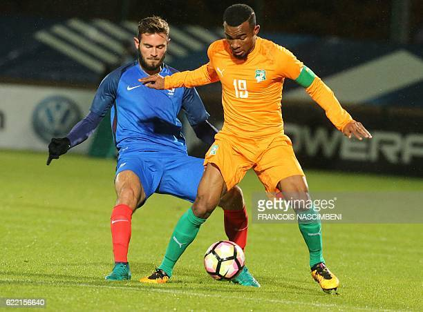 France's midfielder Lucas Tousart vies with Ivory Coast's captain Digho Habib Maiga during the friendly international U21 football match between...