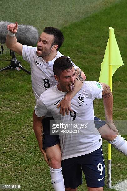 France's midfielder Mathieu Valbuena celebrates with forward Olivier Giroud after scoring during a Group E football match between Switzerland and...