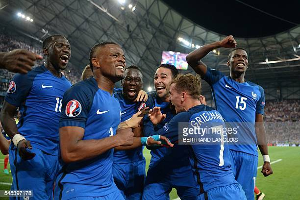 TOPSHOT France's midfielder Moussa Sissoko France's defender Patrice Evra France's defender Bacary Sagna France's defender Adil Rami France's forward...