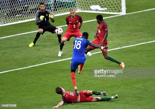 TOPSHOT France's midfielder Moussa Sissoko has an attempt on the goal as he vies with Portugal's midfielder Adrien Silva during the Euro 2016 final...