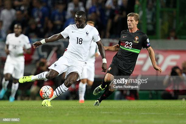 France's midfielder Moussa Sissoko vies with Portugal's midfielder Adrien Silva during the Friendly match between Portugal and France on September 04...