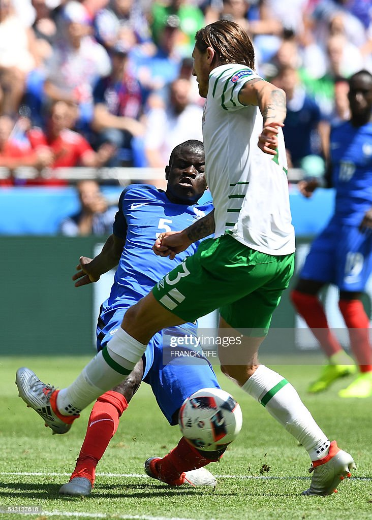 France's midfielder N'Golo Kante (L) and Ireland's midfielder Jeffrey Hendrick vie for the ball during the Euro 2016 round of 16 football match between France and Republic of Ireland at the Parc Olympique Lyonnais stadium in Décines-Charpieu, near Lyon, on June 26, 2016. / AFP / FRANCK