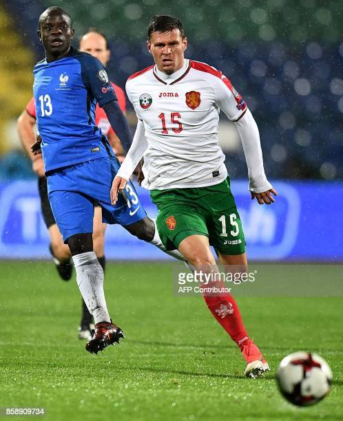 France's midfielder N'Golo Kante fights for the ball with Bulgaria's defender Vasil Bozhikov during the FIFA World Cup 2018 qualifying football match...