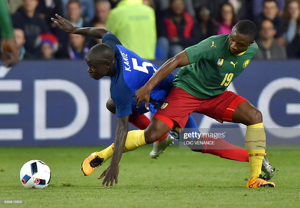 France's midfielder N'Golo Kante (L) fights for the ball with Cameroon's midfielder Sebastien Siani during the International friendly football match between France and Cameroon at the Beaujoire stadium, in Nantes, western France, on May 30, 2016 as part of the French team's preparation for the upcoming Euro 2016 European football championships. / AFP / LOIC