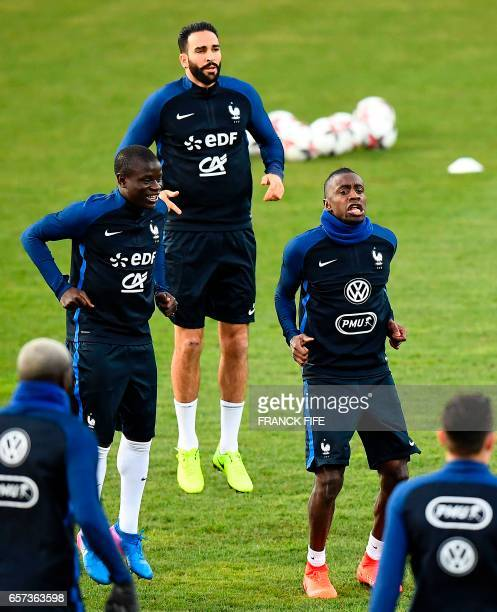 France's midfielder N'Golo Kante France's defender Adil Rami and France's midfielder Blaise Matuidi take part in a training session at the Josy...