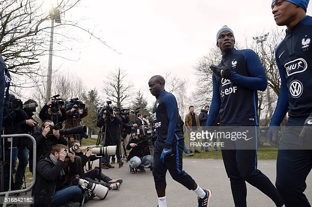 France's midfielder N'Golo Kante midfielder Paul Pogba and forward Anthony Martial arrive for a training session in Clairefontaine en Yvelines on...