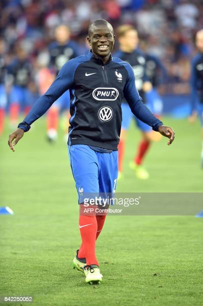 France's midfielder N'Golo Kante reacts as he warms up before the FIFA World Cup 2018 qualifying football match France vs Luxembourg on September 3...
