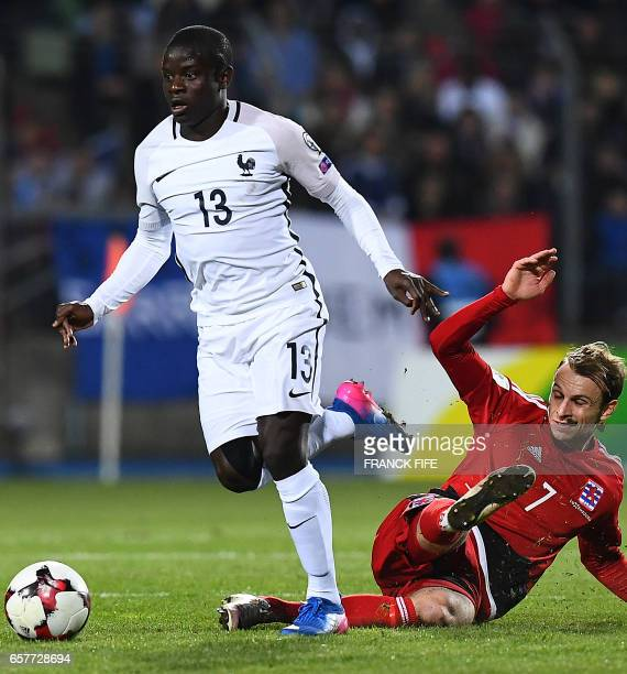 France's midfielder N'Golo Kante vies with Luxembourg's defender Christopher Martins Pereira during the FIFA World Cup 2018 qualifying football match...