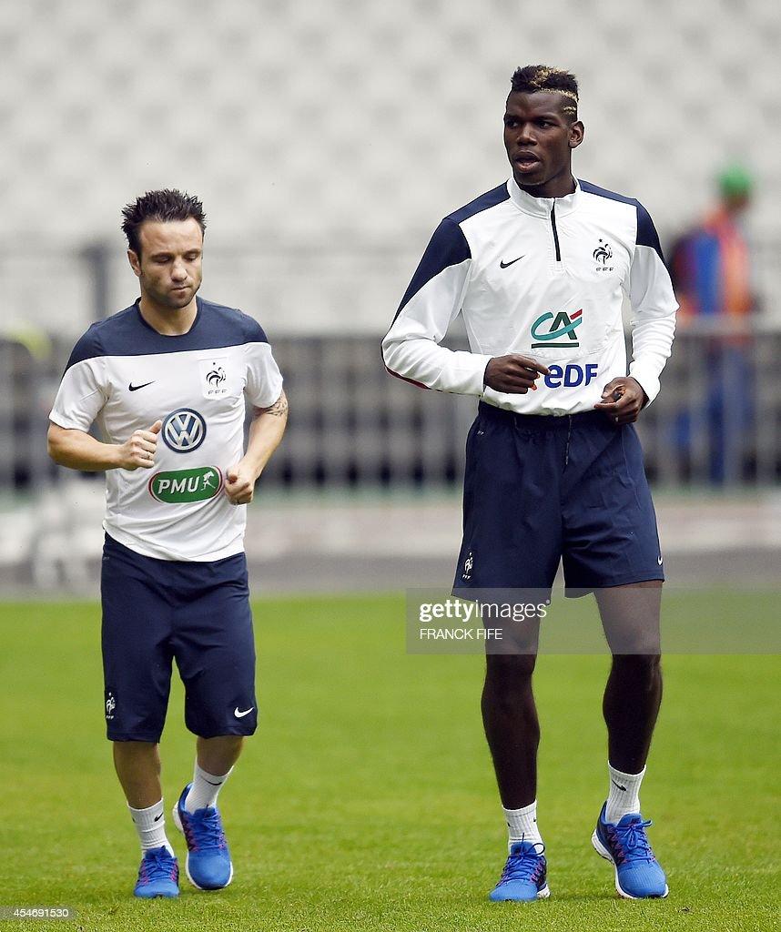 France s midfielder Paul Pogba R and France s midfielder Mathieu