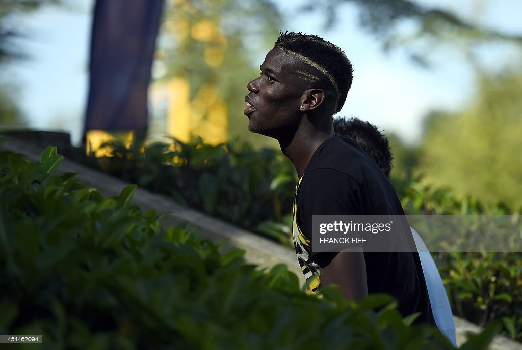 France's midfielder Paul Pogba arrives at the French national football team training base in Clairefontaine on September 1, 2014 on the first day of their training ahead of the friendly football match against Spain to be held on September 4. AFP PHOTO / FRANCK FIFE