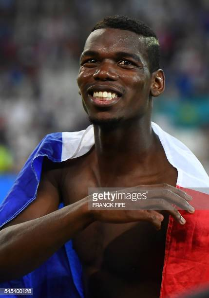 France's midfielder Paul Pogba celebrates after France beat Germany 20 in the Euro 2016 semifinal football match between Germany and France at the...