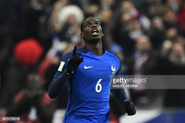France's midfielder Paul Pogba celebrates after scoring a goal during the 2018 World Cup group A qualifying football match between France and Sweden...