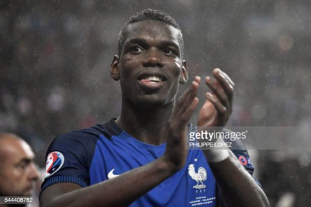 France's midfielder Paul Pogba celebrates after the Euro 2016 quarterfinal football match between France and Iceland at the Stade de France in...