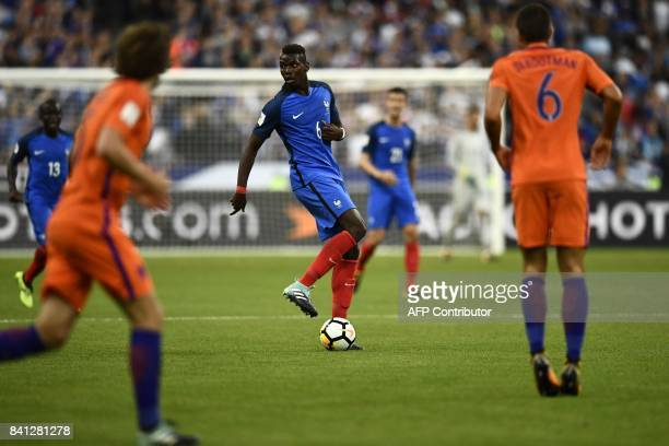 France's midfielder Paul Pogba drives the ball during the 2018 FIFA World Cup qualifying football match France vs Netherlands at the Stade de France...