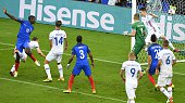 France's midfielder Paul Pogba heads the ball and scores his team's second goal during the Euro 2016 quarterfinal football match between France and...