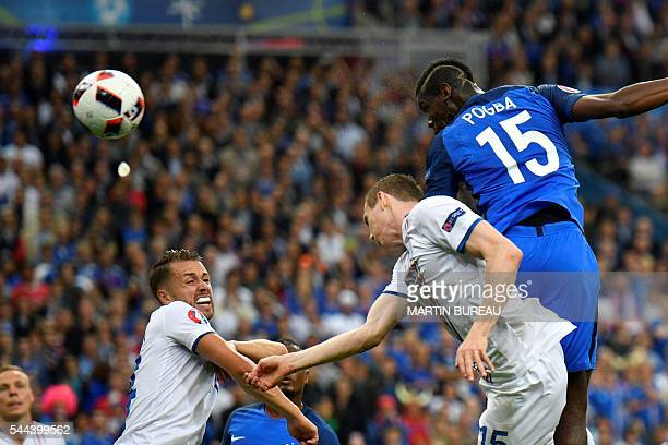 France's midfielder Paul Pogba heads the ball to score a goal past Iceland's forward Jon Dadi Bodvarsson during the Euro 2016 quarterfinal football...