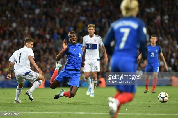France's midfielder Paul Pogba is tackled during the FIFA World Cup 2018 qualifying football match France vs Luxembourg on September 3 2017 at the...