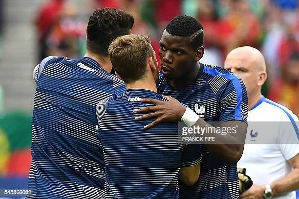 France's midfielder Paul Pogba kisses France's forward Antoine Griezmann prior to the start of the Euro 2016 final football match between France and...