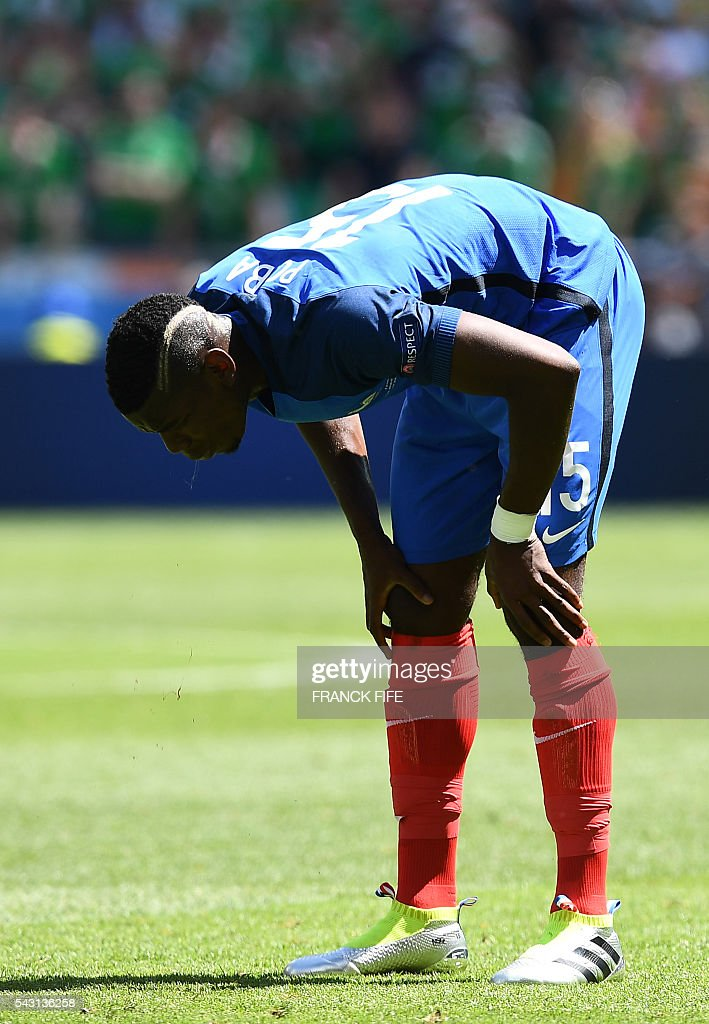 France's midfielder Paul Pogba reacts during the Euro 2016 round of 16 football match between France and Republic of Ireland at the Parc Olympique Lyonnais stadium in Décines-Charpieu, near Lyon, on June 26, 2016. / AFP / FRANCK