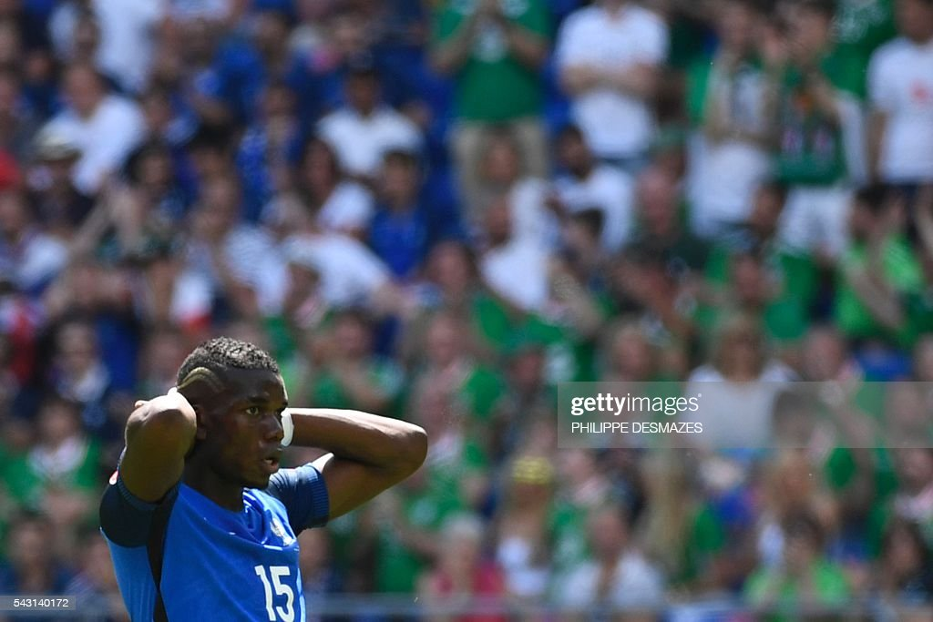 France's midfielder Paul Pogba reacts during the Euro 2016 round of 16 football match between France and Republic of Ireland at the Parc Olympique Lyonnais stadium in Décines-Charpieu, near Lyon, on June 26, 2016. / AFP / PHILIPPE
