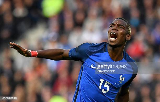 TOPSHOT France's midfielder Paul Pogba reacts to a missed shot during the friendly football match between France and Cameroon at the Beaujoire...