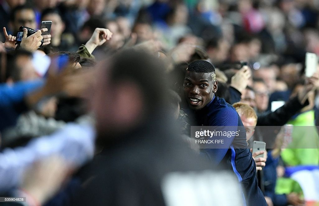 France's midfielder Paul Pogba (R) reacts with supporters after winnning during the friendly football match between France and Cameroon, at the Beaujoire Stadium in Nantes, western France, on May 30, 2016. / AFP / FRANCK