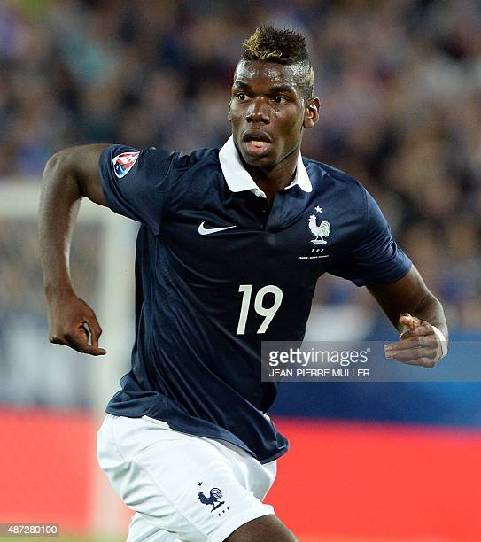 France's midfielder Paul Pogba runs during the Euro 2016 friendly football match France vs Serbia at the Matmut Atlantique stadium in Bordeaux on...